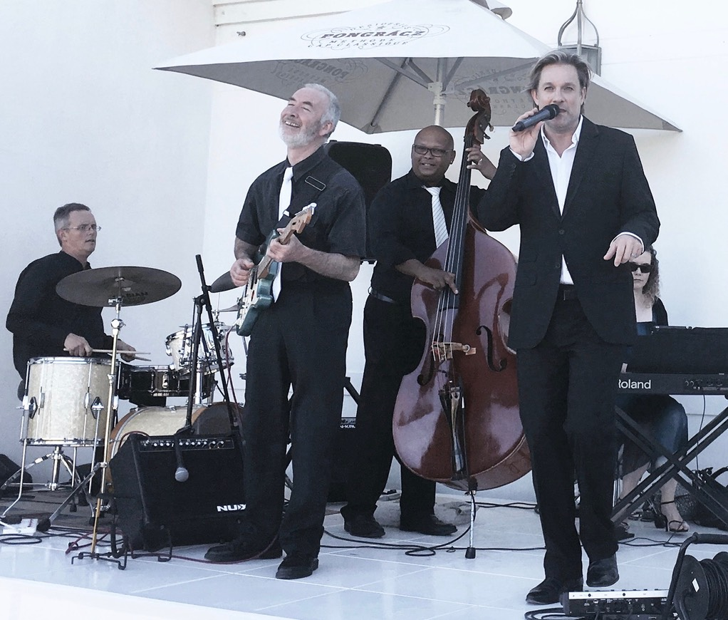 Top wedding singer Ike Moriz sextet at Val de Vie polo estate Paarl swing jazz latin wedding band entertainment live sebastien and christiana cocktail hour