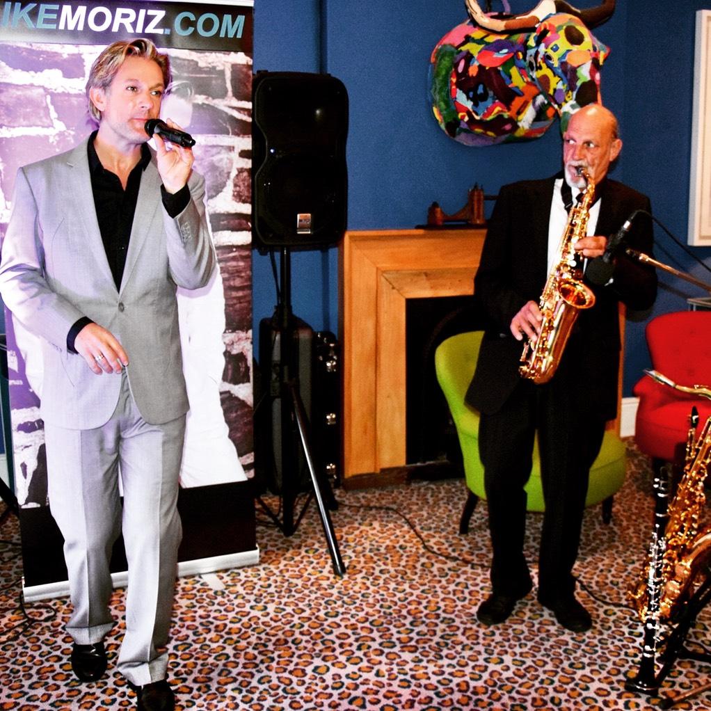 Iker Moriz at The Stack Gardens Cape Town Willie van Zyl swing jazz latin pop duo band entertainment wedding music top singer cape town leopard carpet